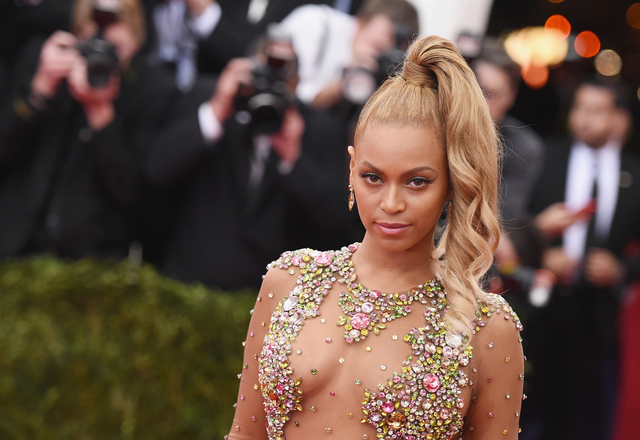 Beyonce rocks Super Bowl, announces world tour