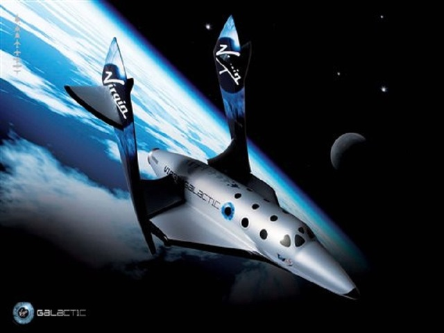Virgin Galactic rolls out new space tourism rocket plane