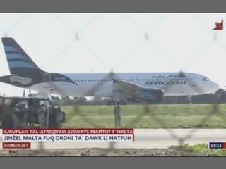 Airplane hijacking ends in surrender