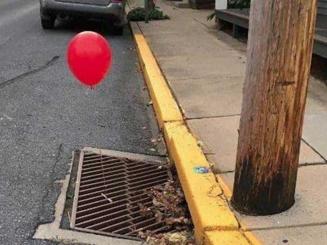 Police 'terrified' after red 'It' balloons tied to sewer grate